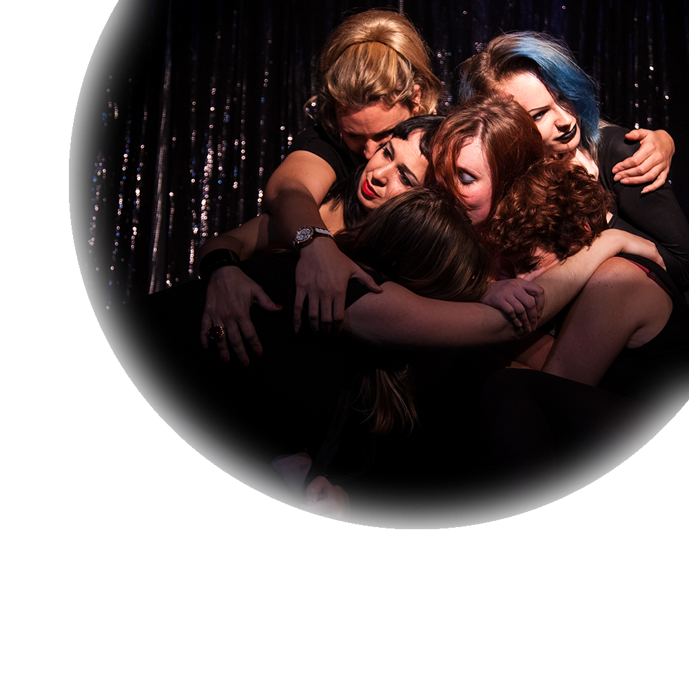 Photo of our cast hugging from the 2014 teaser performance at Bar Wotever at the Vauxhall Tavern